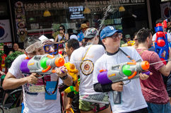 Songkran shooters. Bangkok, Thailand, 13 April 2015. Festival goers at Khao San Road spraying each other with water guns during the annual Songkran water Stock Photography