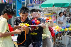 Songkran shooting. Bangkok, Thailand, 14 April 2015. A group of teens shooting water guns at the Khao San Road Songkran Street Party. The annual Songkran water Royalty Free Stock Photos