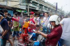 Songkran snake man. Bangkok, Thailand, 13 April 2015. An elderly man gets into the festivities with his own motorscycle-mounted water cannon ath the annual stock photo