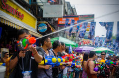 Songkran sniper. Bangkok, Thailand, 14 April 2015. Festival goers at Khao San Road spraying each other with water guns during the annual Songkran water festival stock photo