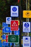 Variety of sign label beside the sreet in big city for warning the drive drive carefully in Songkran festival in Thailand. Songkran warning city Royalty Free Stock Photos