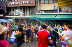Songkran water battle. Bangkok, Thailand, 14 April 2015. Festival goers at Khao San Road spraying each other with water guns during the annual Songkran water royalty free stock images