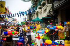 Songkran water battle. Bangkok, Thailand, 14 April 2015. Festival goers at Khao San Road spraying each other with water guns during the annual Songkran water Stock Photos