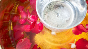 Songkran water for Buddha. Royalty Free Stock Photo