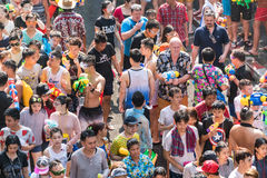 Songkran Water Festival. Annual Songkran Water Festival in downtown Bangkok, Thailand - 2016.  Massive crowds gather to squirt waterguns all over the streets Stock Image