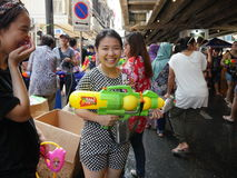 Songkran water festival at Silom road. Bangkok, Thailand-April 13, 2017:Thai people celebrate Songkran by splashing water on each other. Silom road is reserved stock photos