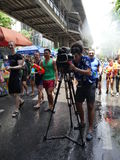 Songkran water festival at Silom road. Bangkok, Thailand-April 14, 2017:Thai people celebrate Songkran by splashing water on each other. Silom road is reserved royalty free stock photography
