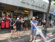 Songkran water festival at Silom road. Bangkok, Thailand-April 14, 2017:Thai people celebrate Songkran by splashing water on each other. Silom road is reserved royalty free stock image