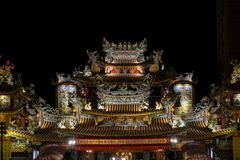 Songshan Ciyou Temple. Taken at night. A famous temple nearby Raohe Night street in Taipei, Taiwan stock photo