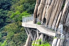 Songshan sanhuang plank walkway and geological formations China. The cliff walkway on Mount Song songshan located within the Shaolin Temple Scenic Area near stock photography