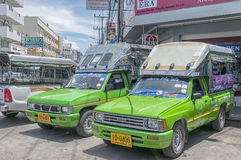 Songthaew Taxi. HUA HIN, THAILAND - SEPTEMBER 23, 2010: Songthaew pick-up truck in the center of Hua Hin. Songthaews are used as public share taxis in Thailand stock photos
