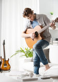 Songwriter composing a song Royalty Free Stock Image