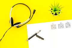 Songwriter or dj work place with notes and headphones on yellow background top view. Songwriter or dj work place with notes and headphones on desk yellow stock photos