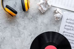 Songwriter or dj work place with vynil and headphones on stone background top view mockup. Songwriter or dj work place with vynil and headphones on stone desk stock image