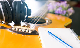 Songwriter with guitar notebook for songwriting Stock Image