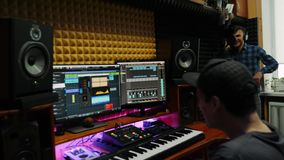 Songwriter and professional singer recording song for new music album at home recording studio. Male vocalist at sound music studi