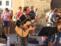 Songwriter and singer Claudio Spadi. JULY 7, Florence: street songwriter and singer Claudio Spadi performs as usual on Ponte Vecchio, on July 7, 2013 in Florence Stock Images