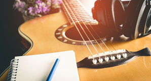 Songwriting equipment, guitar and headphone. Book Stock Photos