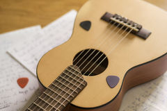 About songwriting passion. A guitar, a piece of paper, some plectrum, some inspiration and a song is ready Stock Photo