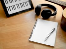 Song Writing. Songwriting Tools, Headphone, Guitar, Notebook, Electronic Tablet and Pen on Wooden Background Stock Images