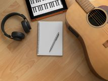Song Writing. Songwriting Tools, Headphone, Guitar, Notebook, Electronic Tablet and Pen on Wooden Background Top View Royalty Free Stock Image