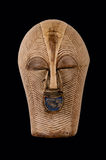 African Mask. Songye Kifwebe ceremonial female mask from Congo/Africa, carved in wood with pigment/kaolin patina, isolated on black royalty free stock image