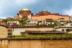 Songzanlin Lamasery of Yunnan. Songzanlin Lamasery. It was described as small Potala Palace is the maximal Tibetan buddhism lamasery of Yunnan. It was located in Stock Photography