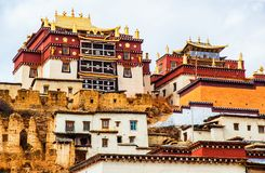 Songzanlin Lamasery of Yunnan. Songzanlin Lamasery. It was described as small Potala Palace is the maximal Tibetan buddhism lamasery of Yunnan. It was located in Royalty Free Stock Photo
