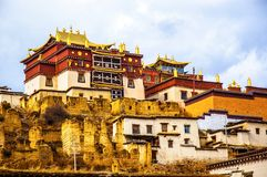 Songzanlin Lamasery of Yunnan. Songzanlin Lamasery. It was described as small Potala Palace is the maximal Tibetan buddhism lamasery of Yunnan. It was located in Stock Photos
