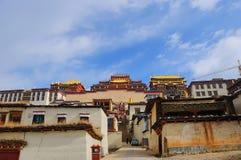 Songzanlin Monastery at Shangr-la, Yunnan China. SHANGRI-LA, CHINA Anonymous tourists come to admire the view of Songzanlin Monastery, the largest Tibetan stock image
