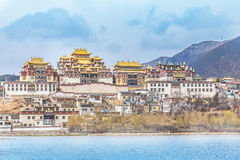 Songzanlin Temple and beautiful landscape. Landscape with tibetan monastery and lake in Zhongdian city china Stock Photo