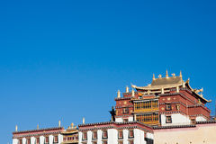 Songzanlin, Tibetan monastery in Shangrila city, Yunnan province. China. with blue sky Royalty Free Stock Image