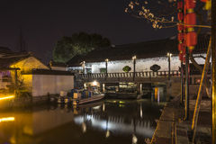 Songzilaifeng bridge at night. Songzilaifeng Ancient bridge at night.This photo was taken in Xitang Town, Jiaxing city,Zhejiang province,china Royalty Free Stock Image