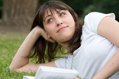 Sonhos do livro da menina Foto de Stock Royalty Free