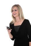 Sonia che esamina telefono Fotografia Stock Libera da Diritti