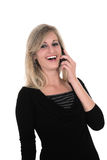 Sonia on her cellphone. Business woman in black laughing over the phone Royalty Free Stock Photos