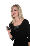 Sonia looking at phone. Business woman in black looking at her phone royalty free stock photography