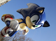 Sonic balloon in Macy's parade. NEW YORK CITY, NY - NOVEMBER 24: Sega Sonic The Hedgehog flying through the city streets of the Macy's 85th Annual Thanksgiving Royalty Free Stock Photography
