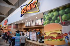 Sonic Restaurant in a Mall. Sonic Restaurant Neon Sign, Sonic Drive-In, more commonly known as Sonic, is an American drive-in fast-food restaurant chain based Royalty Free Stock Image