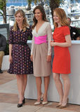 Sonja Richter & Hilary Swank & Miranda Otto. CANNES, FRANCE - MAY 18, 2014: Sonja Richter (left), Hilary Swank & Miranda Otto at the photocall for their new Royalty Free Stock Image