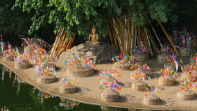 Sonkran festival ,religion flag pinned on sand pagoda in Temple. stock footage
