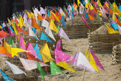 Sonkran festival ,religion flag  on sand pagoda in temple. Royalty Free Stock Images
