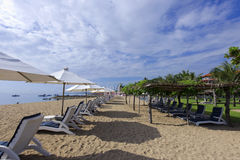 Sonne des Strandes morgens Lizenzfreie Stockbilder