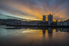 Sonnenaufgang über dem Hafen von Halden Stockfotografie