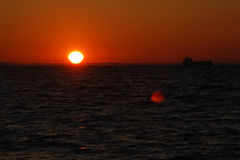 Sonnenaufgang über dem Meer Stockfotos