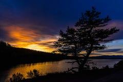 Sonnenaufgang über Hauser stockbild