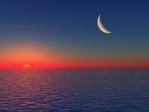 Sonnenaufgang über Meer mit Mond Stockfotos