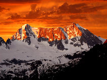 Sonnenaufgang über Presanella Stockbild