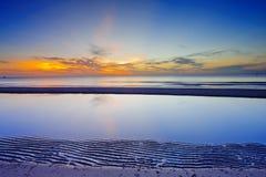 Sonnenaufgang auf dem Strand Lizenzfreie Stockfotos