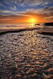 Sonnenaufgang auf einem Strand Lizenzfreie Stockfotografie